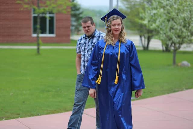 girl in graduation gown walking