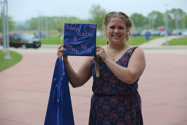 female graduate showing off cap