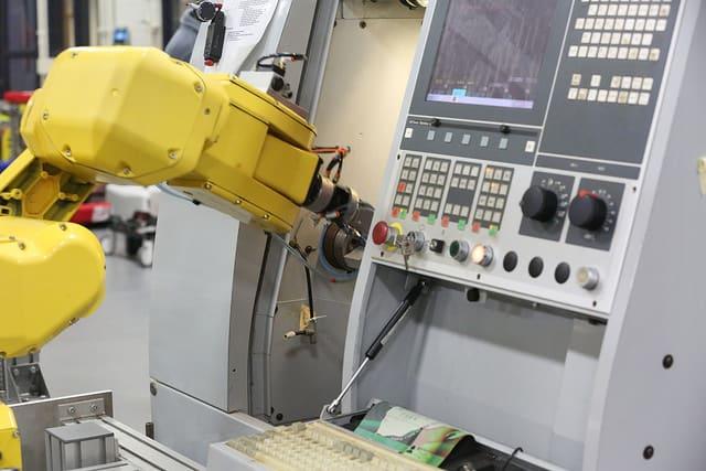 Tech machine building a pen.