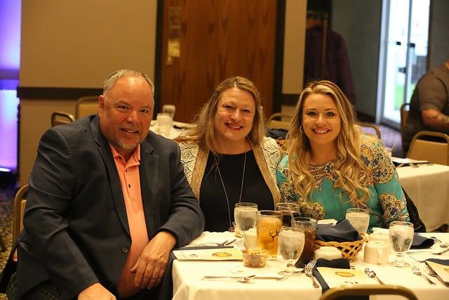 Family posing at table.