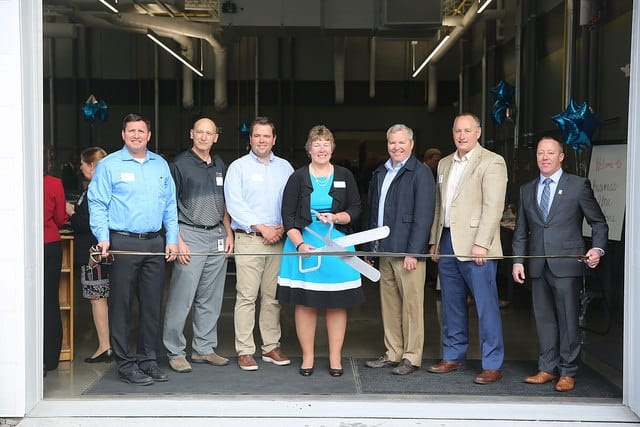 Major donors for energy education center participate in ribbon cutting.