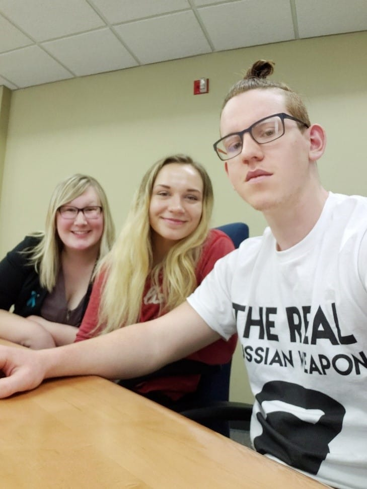 Jonah Tyjeski (right), Natalie Bock (center), and Stephanie Munro (left), students in the English Composition I course, explain how they will use their writing skills in their future careers.