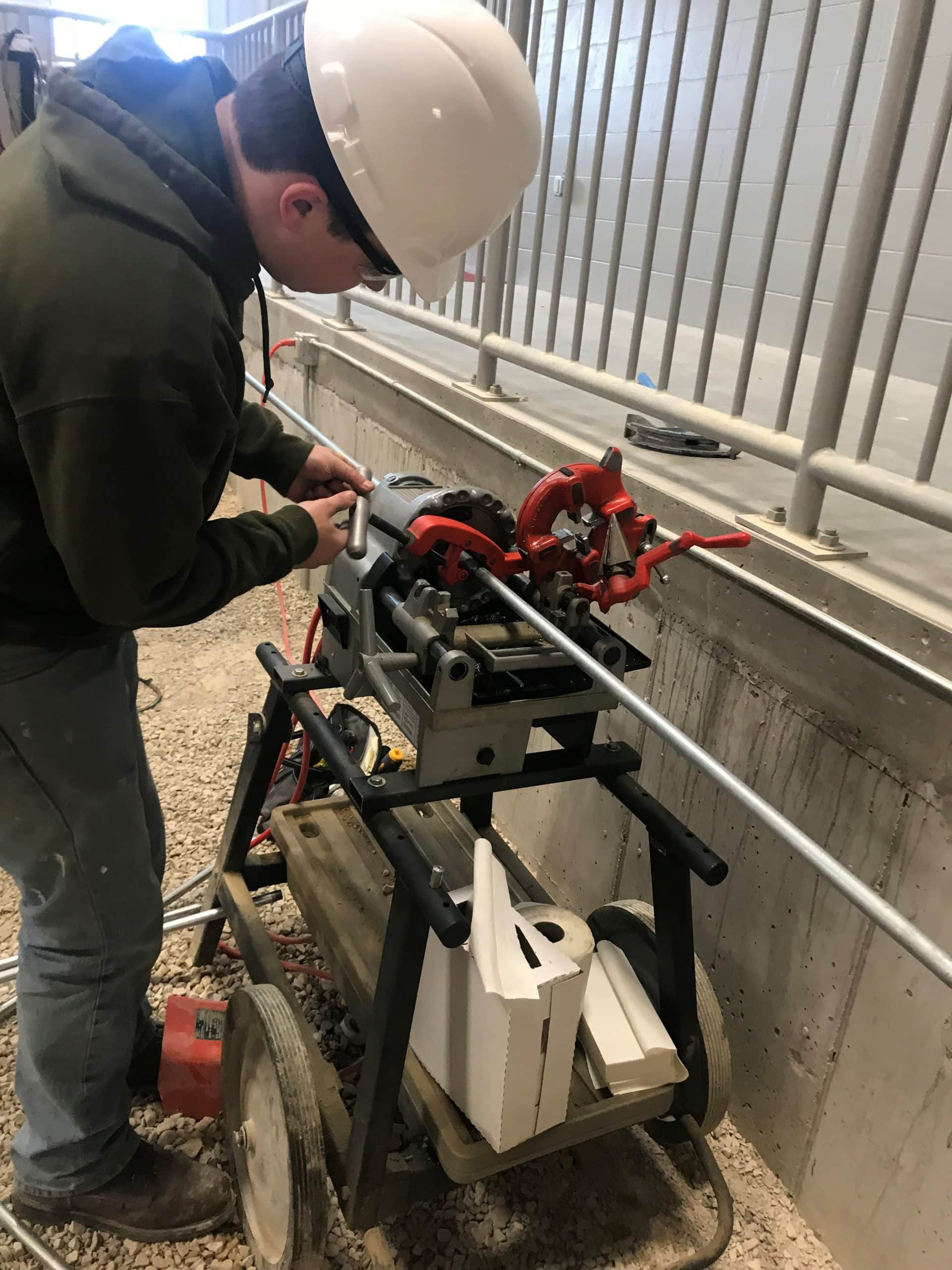 student works on machinery