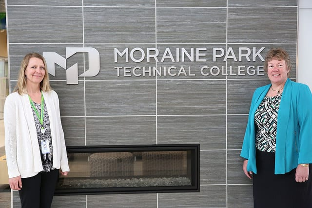 Bonnie & Michelle in front of Moraine Park sign