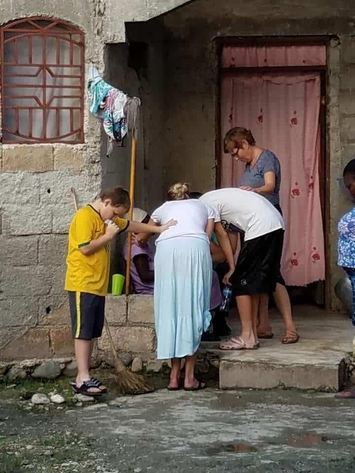 praying at orphanage in Haiti