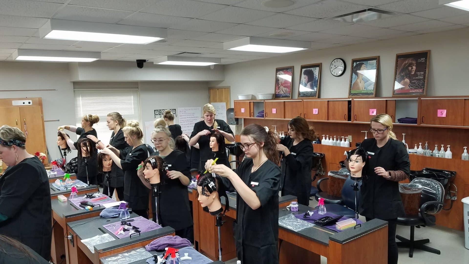 Cosmo students testing on manikin heads