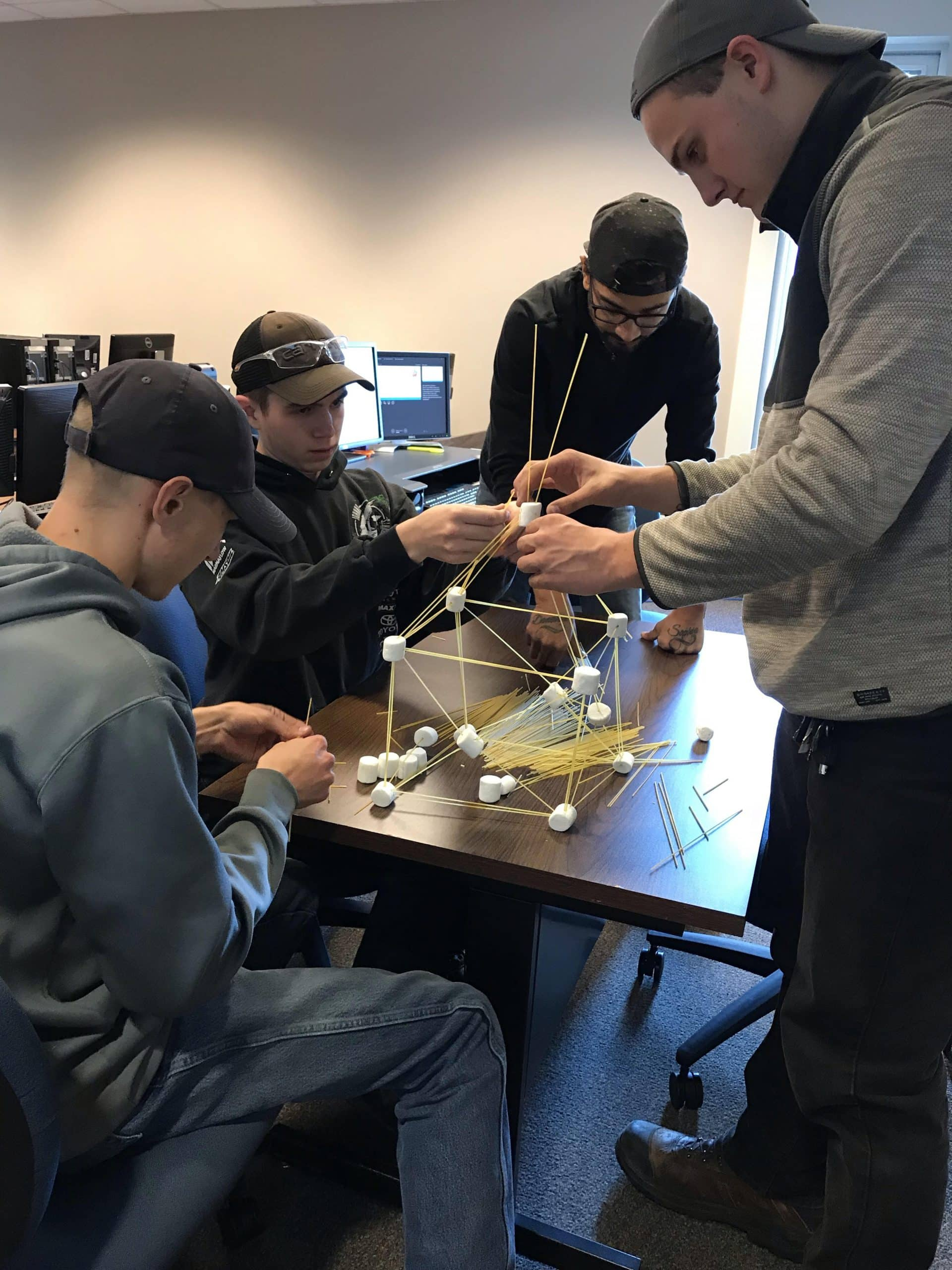 CNC Students building marshmallow towers