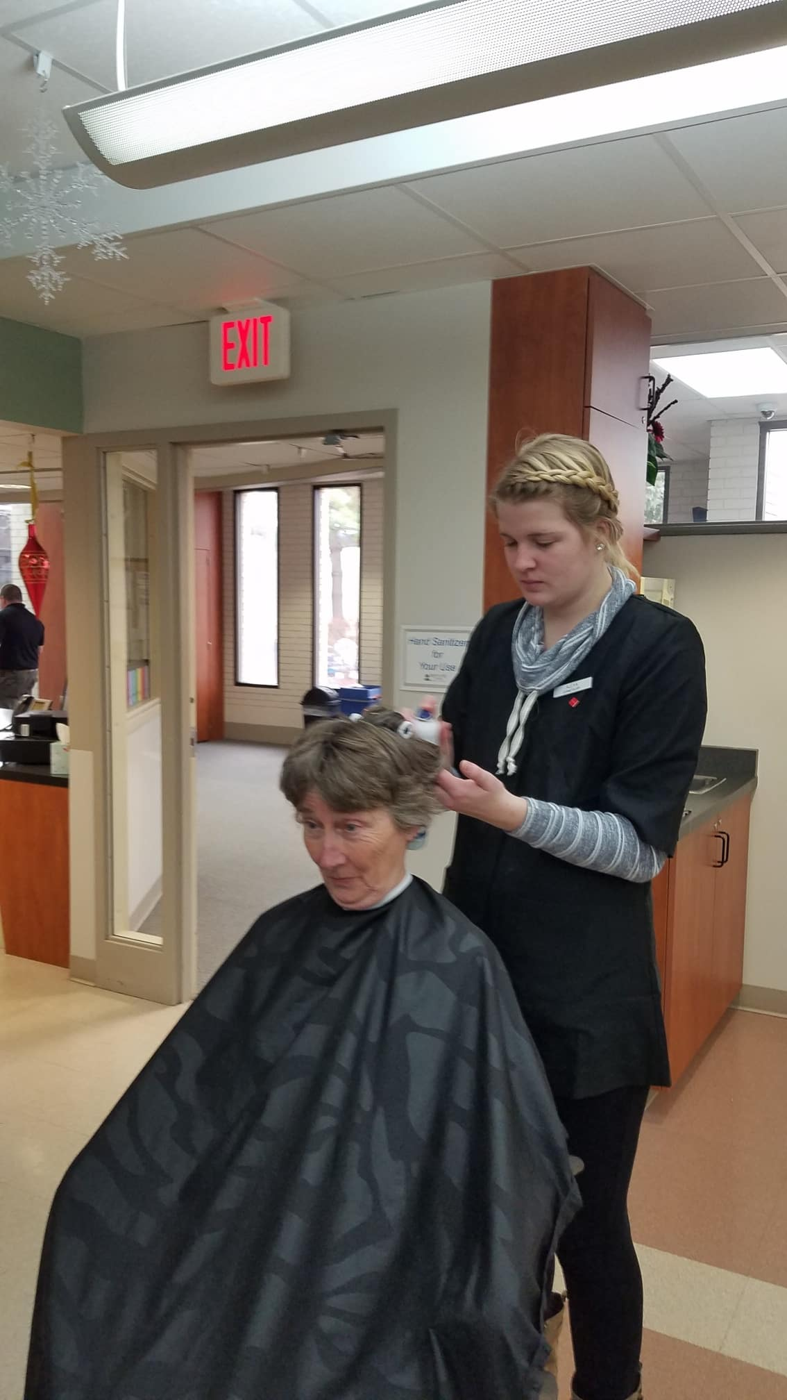 Cosmetology student working on a client