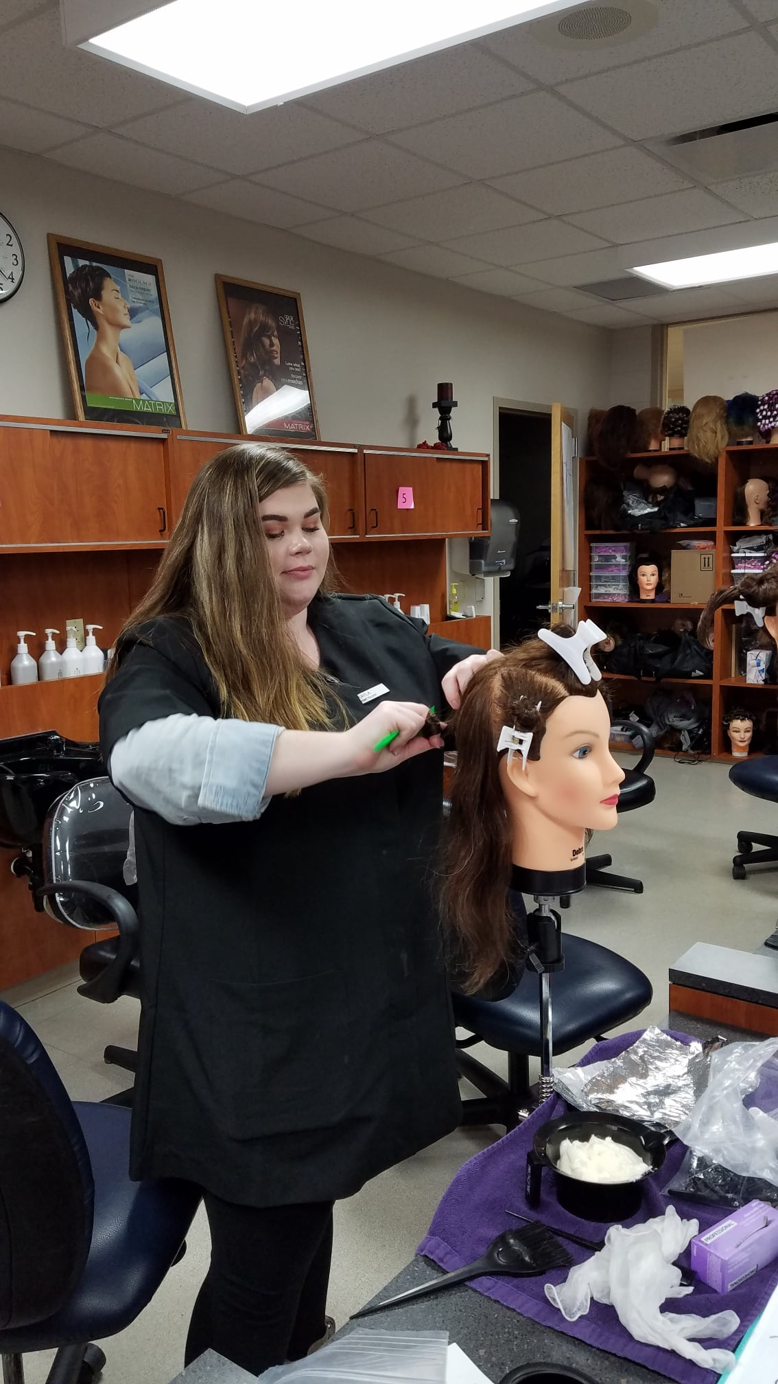 Cosmo student applying color to manikin