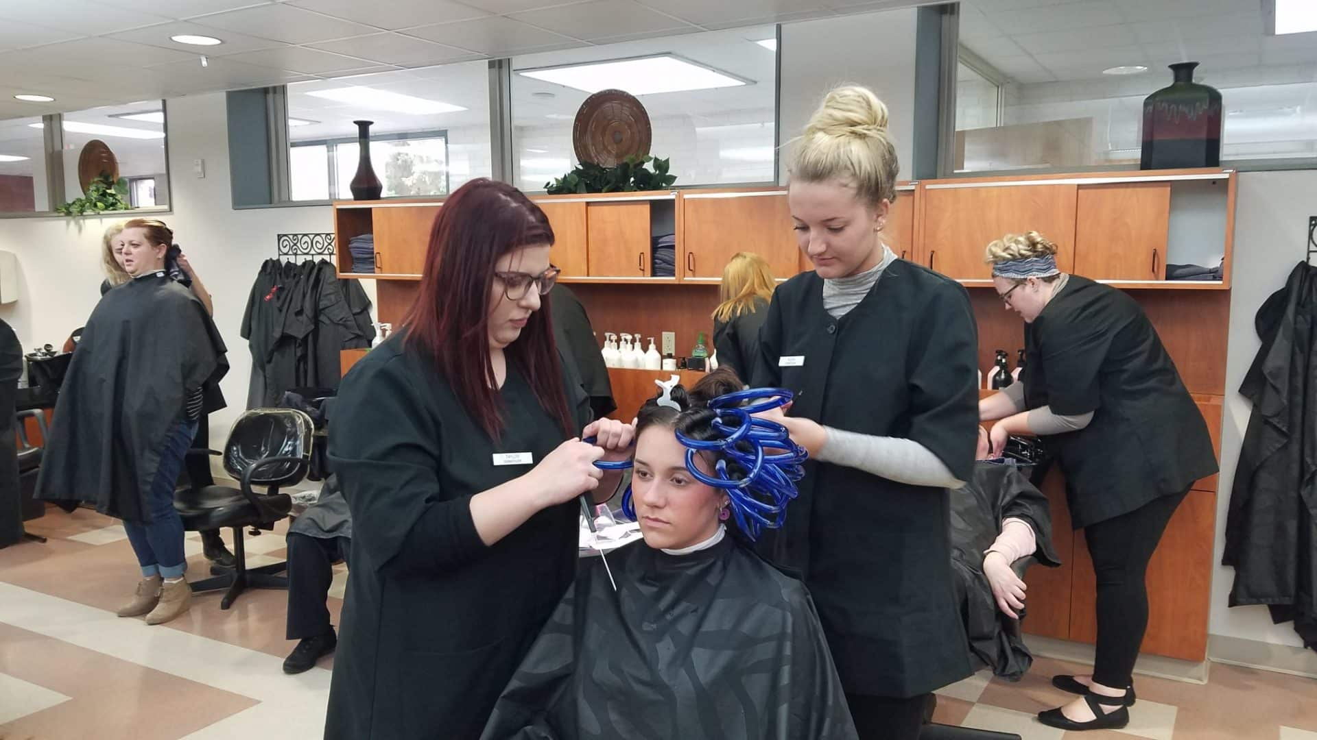 Cosmo students performing a perm