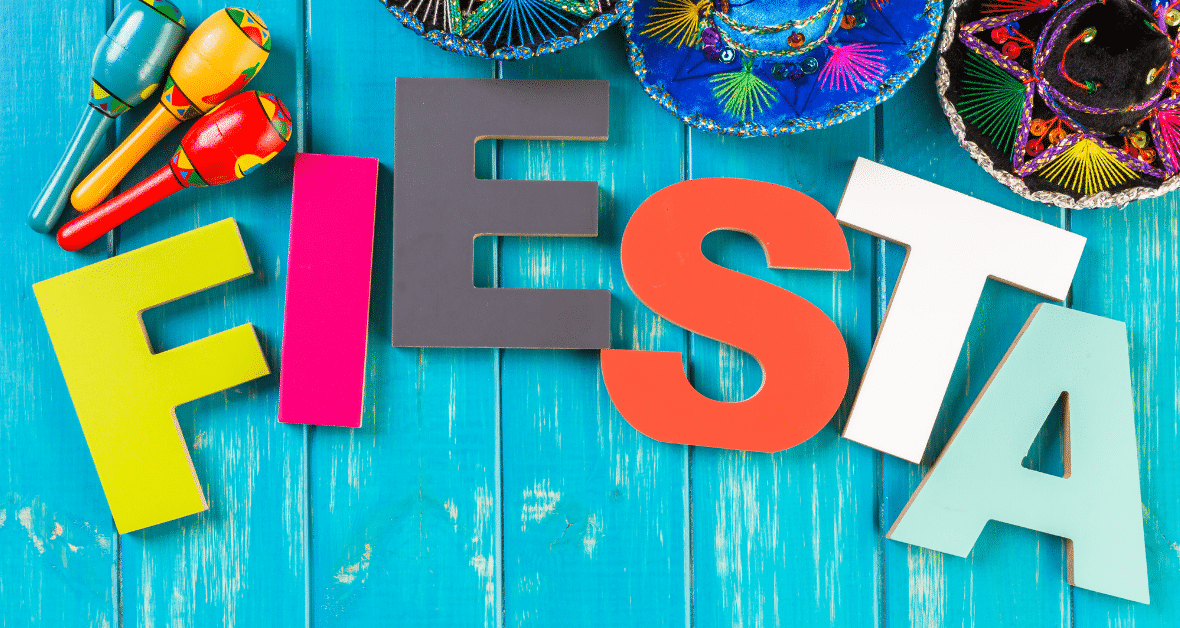 "colorful tabletop with sombreros, maracas and letters that spell out ""Fiesta"""