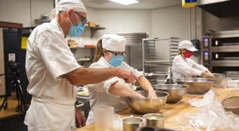 Students and instructor making bread